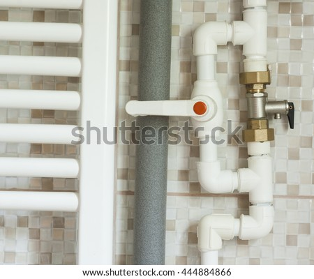 closeup of water pipes inside bathroom - stock photo