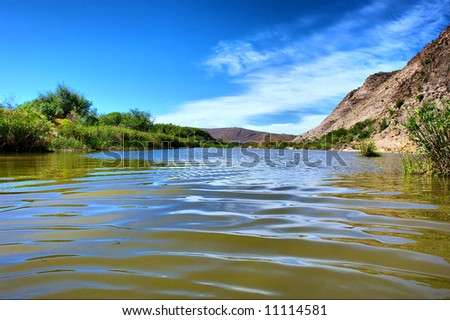 Closeup of wave on awesome river in mountains. Shot in the Langeberge highlands near Grootrivier river, Garden Route, Western Cape, South Africa. - stock photo
