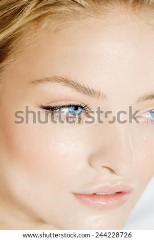 Closeup of wet face. Beauty concept of skin moisturizing. - stock photo