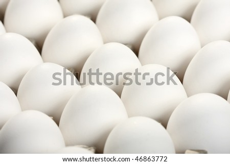 Closeup of white eggs, food background