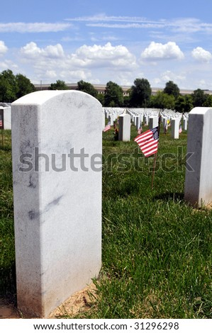 Closeup of white marble gravestone with copyspace and an American flag - stock photo