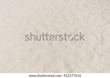 closeup of white sand pattern of a beach in the summer.