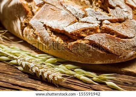 Closeup of wholemeal bread on old wooden table