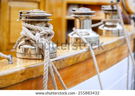 Closeup of winches with lines on a large sailing boat - stock photo