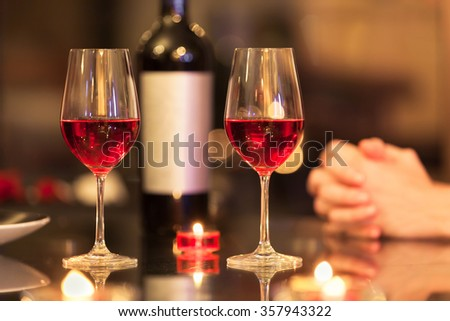 Closeup of wine glasses in a restaurant.  - stock photo