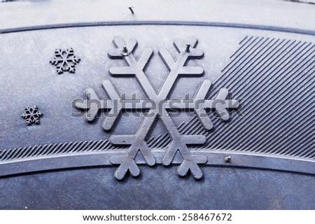 Closeup of winter tire's sign - stock photo