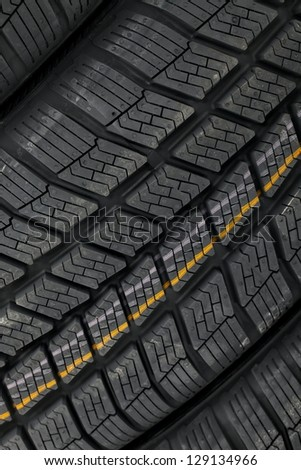 Closeup of winter tyre patterns - stock photo