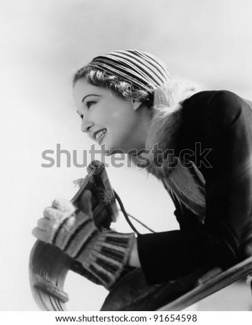 Closeup of woman at front of toboggan - stock photo