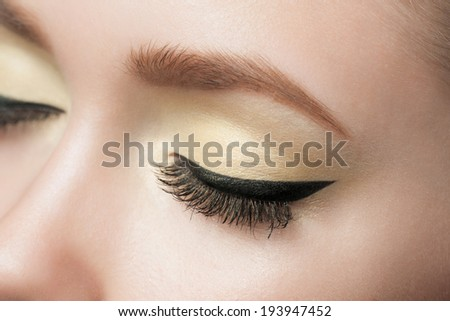 Closeup of woman eye with beautiful makeup with black eyeliner