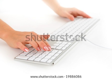 closeup of woman hands typing