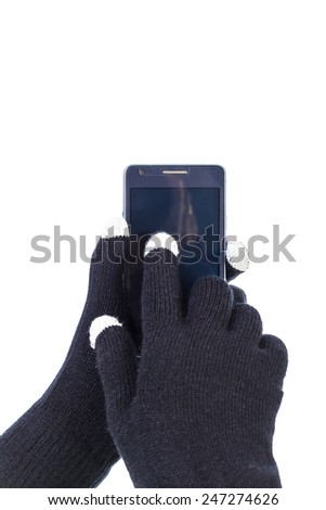 Closeup of woman hands with touchscreen gloves holding a  smart phone.White background - stock photo