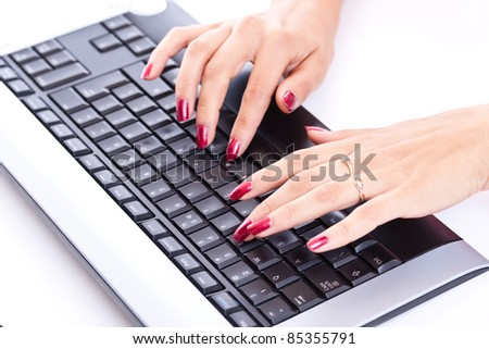 Closeup of woman hands working on computer keyboard