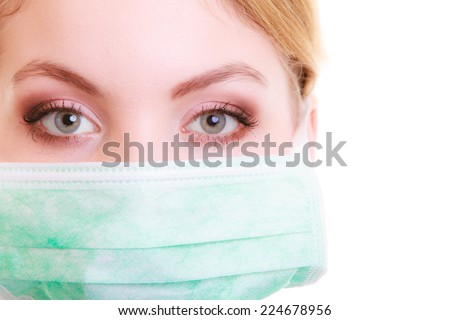 Closeup of woman in green face mask. Doctor or nurse isolated. Safety in risk work. - stock photo