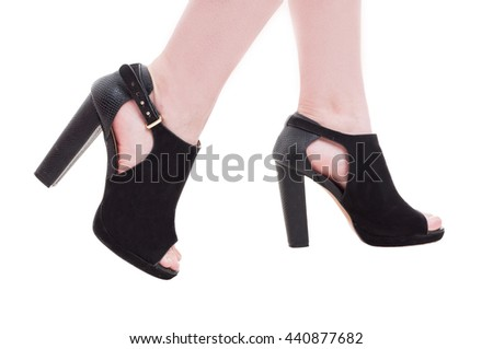Closeup of woman legs with fashionable black cutout boots as glamour and modern footwear concept isolated on white background