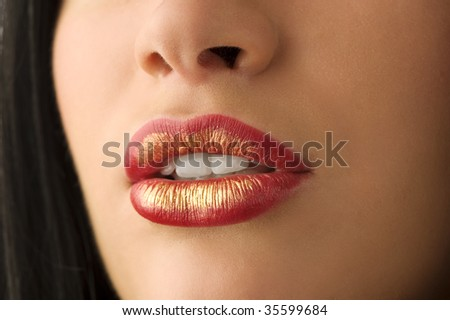 closeup of woman mouth with red and golden colored lips - stock photo