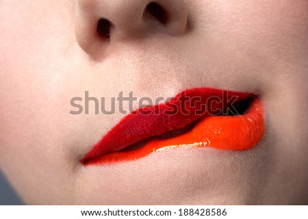 closeup of woman'??s red coral and orange colour lips on clear skin  - stock photo