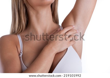 Closeup of woman showing her waxing armpit