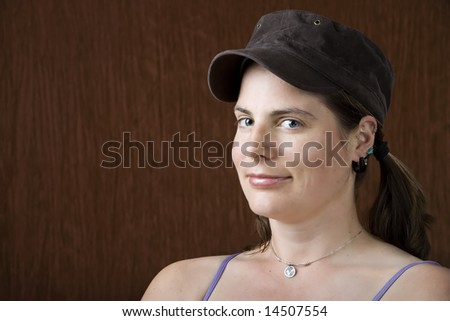 Closeup of woman with blue eyes wearing a cap - stock photo