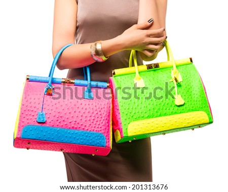 Closeup of woman with bright fashion leather neon bag. Isolated on the white studio background. - stock photo