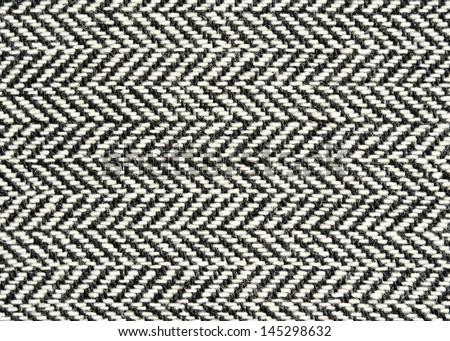 Closeup of wool herringbone fabric - stock photo