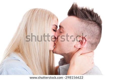 Closeup of young beautiful couple kissing isolated on white background - stock photo