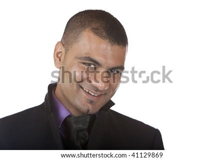 closeup of young businessman smiling into camera, isolated on white background.