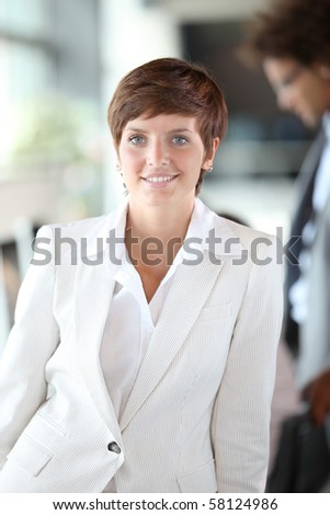 Closeup of young businesswoman in the office - stock photo