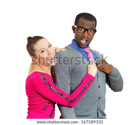 Closeup of young couple, excited woman, girlfriend pulling money out of man pocket, he looks shocked, surprised. Isolated on white background. Shopping lover, reckless spending. Human face expressions - stock photo