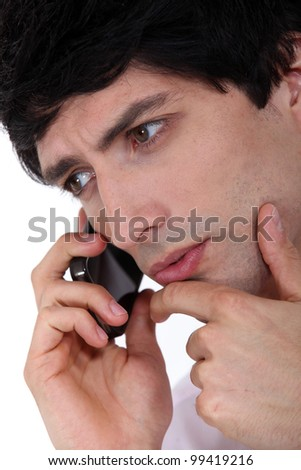 closeup of young man talking on the phone