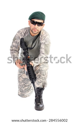Closeup of young soldier or sniper aiming with an automatic gun isolated on white background - stock photo
