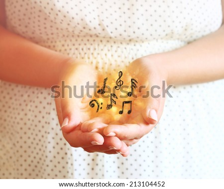 closeup of young woman hands. hands outstretched in cupped shape. selective focus. retro toned image.  - stock photo