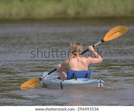 Closeup of young woman kayaking - stock photo