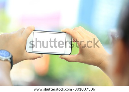 closeup of young woman use smart phone in city