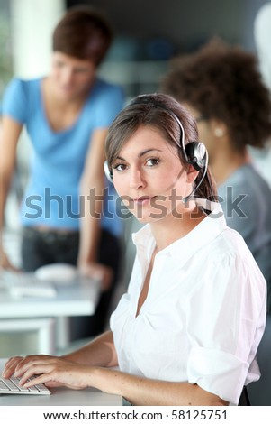 Closeup of young woman with headphones - stock photo
