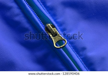 Closeup of zipper on coat with texture - stock photo
