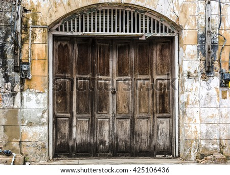 closeup old wooden door in abandoned building creepy background - stock photo
