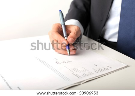 Closeup on a man's hand writing - stock photo