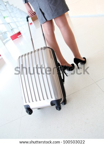 Closeup on cabin luggage pulled by businesswoman - stock photo