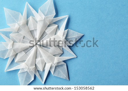 Closeup on christmas snowflake paper 3d. - stock photo