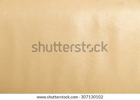 Closeup on cracked leather texture background. - stock photo