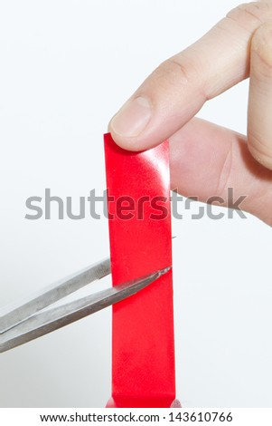 Closeup on Cutting The Red Tape - stock photo
