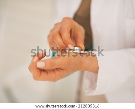 Closeup on doctor woman measuring pulse