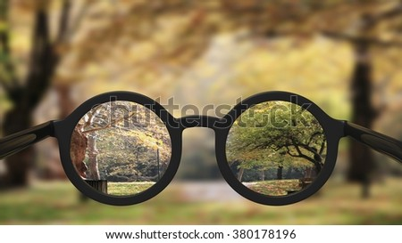 Closeup on eyeglasses with focused and blurred landscape view.  - stock photo