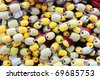Closeup on fishing net with yellow and white floaters - stock photo