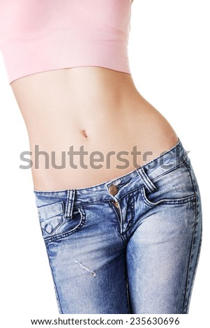 Closeup on fitness woman showing flat belly. - stock photo