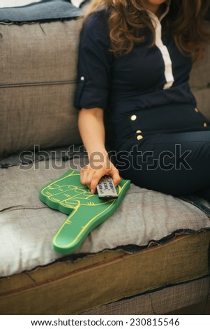 Closeup on football fan woman watching tv - stock photo