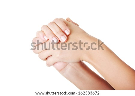 Closeup on hands. Female. Isolated on white.