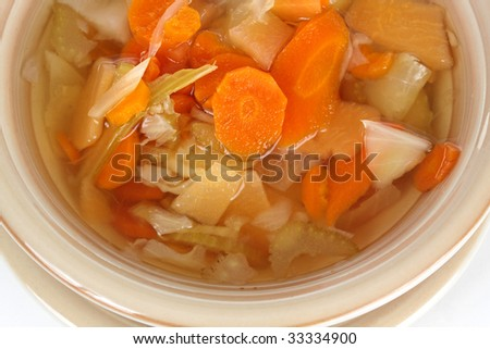 closeup on homemade vegetable soup in a beige bowl