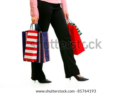 Closeup on legs and hands with shopping bags isolated on white - stock photo