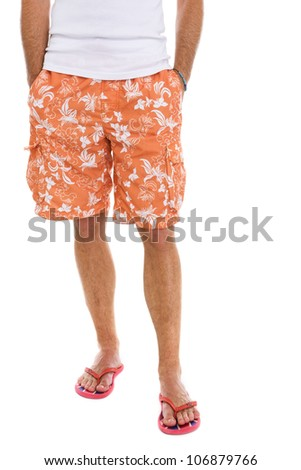 Closeup on legs of male in shorts and flip flops - stock photo